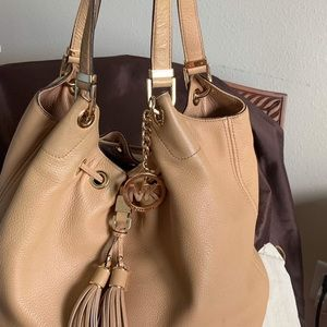 Tan handbag gently used well taken care dust bag